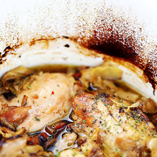 Crock Pot Chicken Thighs with Artichokes and Sun-Dried Tomatoes.