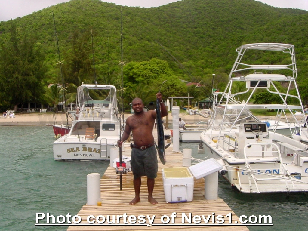 Photo: Fishing at Oualie Beach Hotel's Pier. Nevis, West Indies. http://nevis1.com/oualie-beach-hotel.html