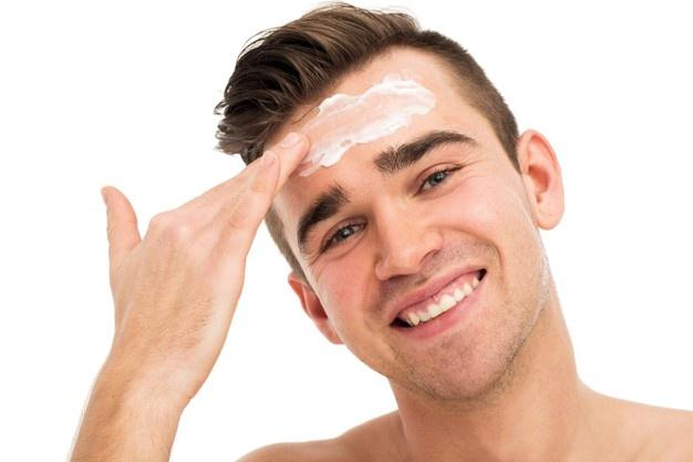 Man using face mask for skin care  Kaolin Clay