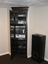 Photo: A look at the equipment closet from the front.  Top to bottom: Upstairs living room AVR (Onkyo) Basement HT AVR (HK) Basement HTPC/Virtual WHS 2011 Upstairs living room HTPC