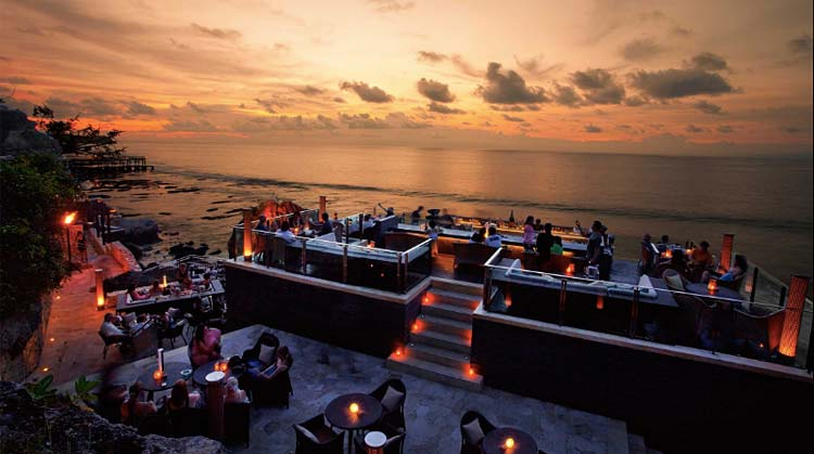 Take in the sunset and rolling waves at the Rock Bar at the Ayana Resort & Spa in Bali.