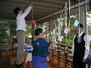 Photo: Decklin & Claudia hanging up the stars received