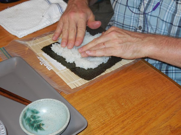 If you don't have a sushi mat, you can just spread out a piece...