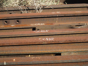 "Photo: Old rails laying around. Most of them marked ""scrap"" with a few marked ""Keep"". Manufactured by the Krupp corporation in 1979. I wonder when it was the last time someone moved these."