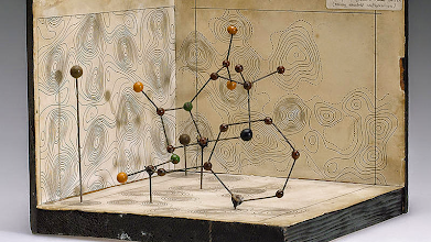 Photo: Model of the structure of penicillin, by Dorothy Hodgkin, Oxford, c. 1945 --------------------------------------------- Biophysicists and biochemists are yielding more and more examples of biochemical entanglement patterns every day, particularly in the area of 'systems chemistry'.  The smallest units of organization in systems chemistry are not physical objects in the ordinary sense;they are forms, ideas which can be expressed unambiguouslyonly in mathematical language.  Recent discoveries suggest information is in some sense made of information which comes in bits -- irreducible yes-no, on-offdecisions -- that can be modeled with the '0's and '1's that comprise base-2 systems.
