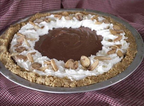 Scoop and smooth into graham crust then garnish with drizzled chocolate syrup (sprinkle chopped...