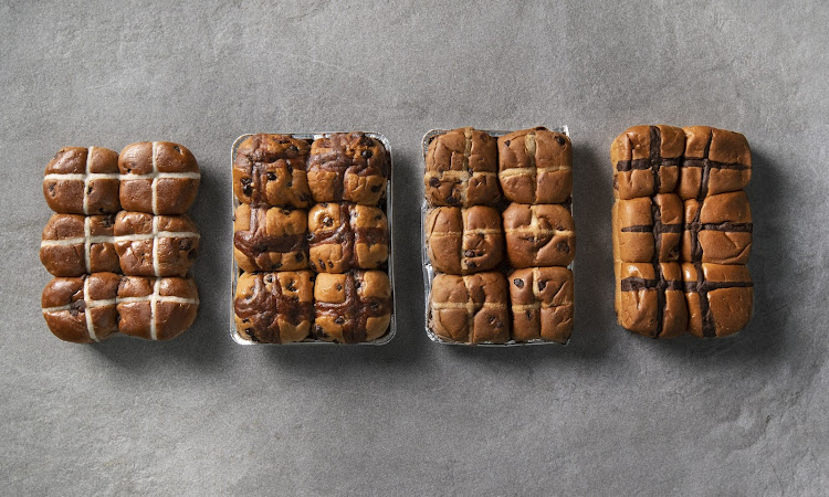 Chocolate hot cross buns from, from left, Woolworths, Checkers, SPAR and Pick n Pay.