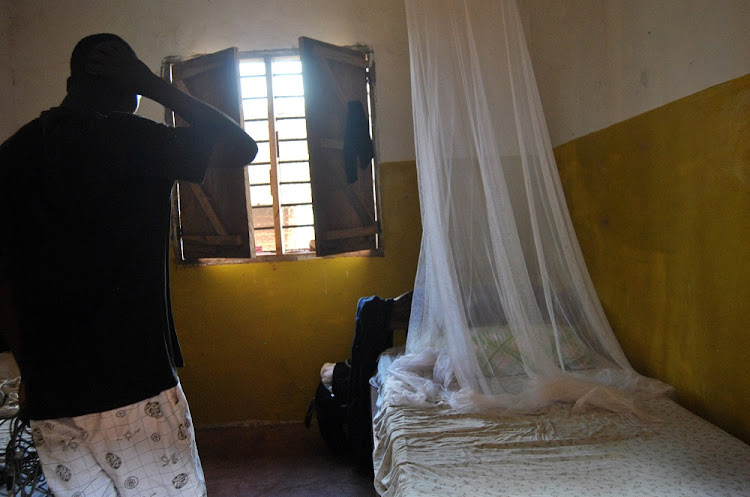 A resident stands inside the room, where Italian volunteer for the Italian charity Africa Milele lived before she was seized in Chakama, Kenya on Wednesday.