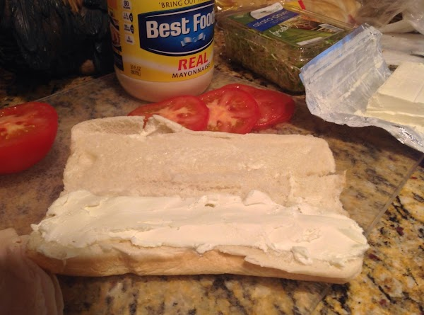 Spread cream cheese on bun liberally, or as much as you need to taste...
