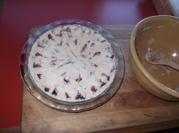 Sprinkle remaining crust mixture on top of fruit.