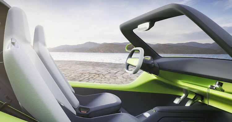Even the traditional gear lever has been squeezed onto the steering wheel in the super-minimalistic interior. Picture: SUPPLIED