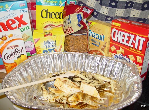 Heat oven to 250°F. Adjust rack(s) to middle positions.   Measure out cereals, crackers, and...
