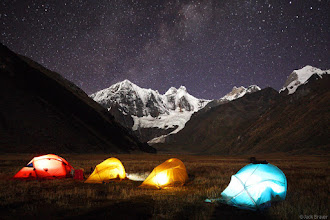 Photo: Colorful tents and nighttime stars at our camp below moonlit Jirishanca (6094m).