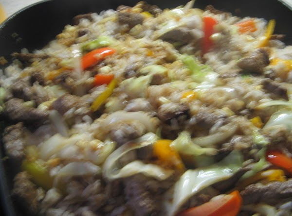 Add the cooked  rice, the remaining 1/2 cup water,chili sauce, soy sauce and...