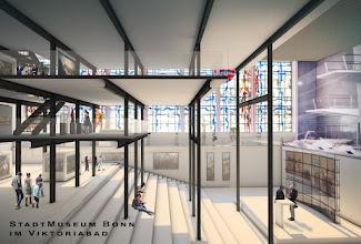 Photo: Visualisierung des StadtMuseums Bonn in der Schwimmhalle des Viktoriabades ©David Breuer aus  http://www.koelnarchitektur.de/pages/de/news-archive/17384.htm. (Keine Angst: Geländer sind als Glasplatten angedeutet.)