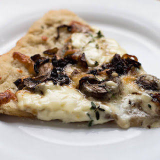 Puff Pastry Pizza with Caramelized Onions, Mushrooms, and Mascarpone.