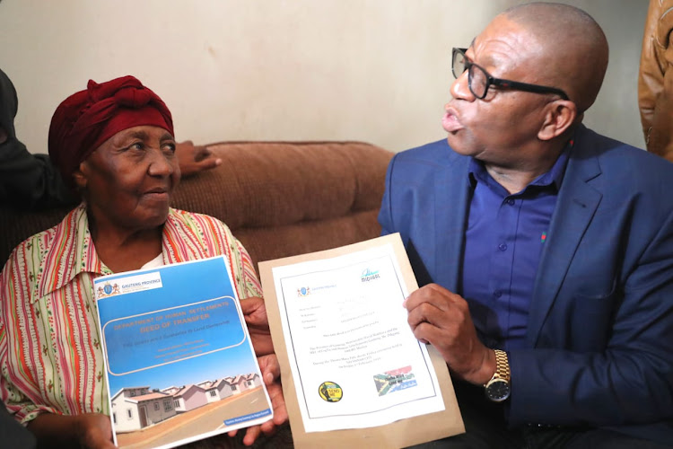 MEC for human settlements Uhuru Moila delivers a title deed to Lydia Sealanyane in Savanna City, Emfuleni Local Municipality.