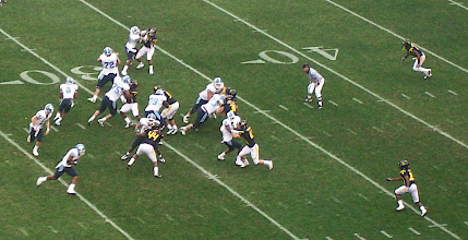 Photo: Yates hands off on a run play.