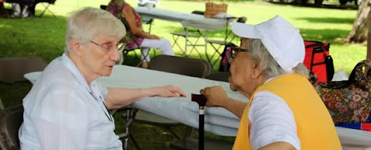 Photo: Sr. Damien chats with an Alumna during Alumni Sunday in July. It's a great opportunity to catch up on what is happening in each other's lives.