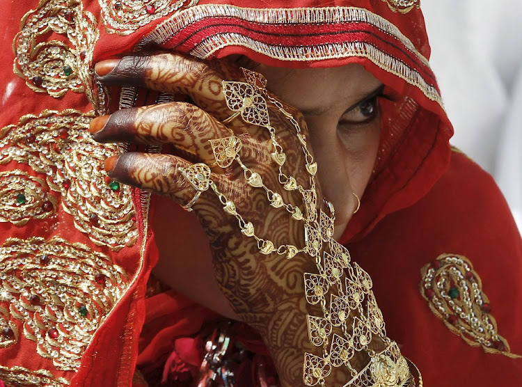 A Muslim bride waits for the start of a mass marriage ceremony in Ahmedabad, India. Picture: REUTERS