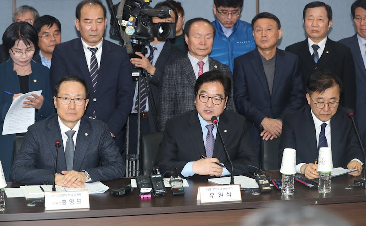 Woo Won-shik, floor leader of South Korea's ruling party, speaks at a meeting to discuss the restructuring of GM Korea in the city of Gunsan, southwest of Seoul, on March 8, 2018.