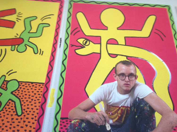 Keith Haring working on a mural in Paris.