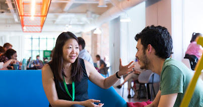 Woman and man seated in conversation, Residency, Campus Madrid, Google for Startups