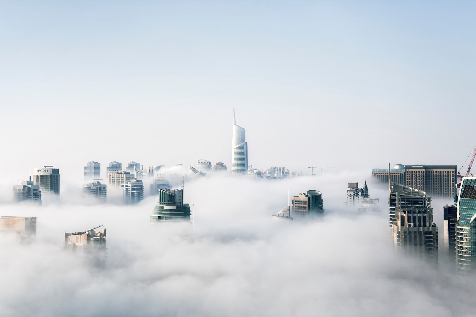 Buildings poke through clouds