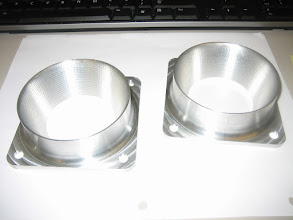 Photo: Intake flanges to adapt RSA-5 Bendix Fuel Injection Servo to K&N RU-2990 air filter.  Designed in SolidWorks, machined on a CNC machine at TechShop.  One for us, one for Tim Andres.