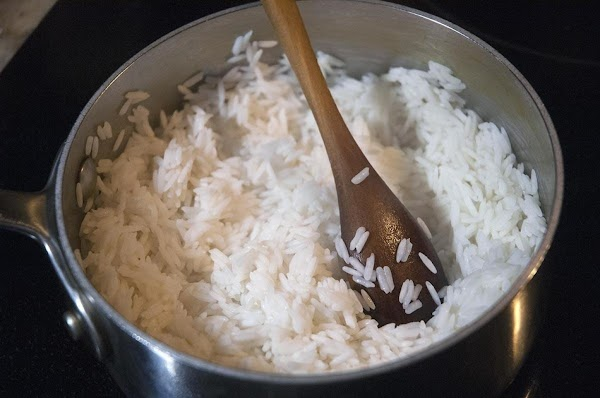 Cook the rice using 50% less water than recommended, and cut the cooking time...