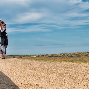 Jumping in the sun by Tristan Wright - Babies & Children Children Candids ( child, playing, sand, sky, jumping, candid, beach, childhood,  )