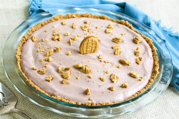 Creamy Chocolate Peanut Butter Pie Decorated With Nutter Butters.