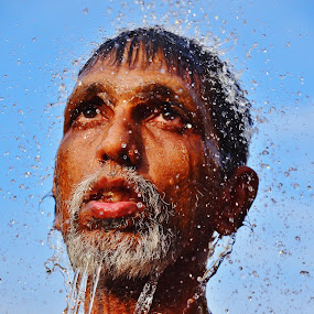Ritual Bath by Domi Chung - People Portraits of Men ( thaipusam, faces, male, bath, asia, indian, india, senior citizen, portraits, people, asian, face, photography, closeup, close, up,  )