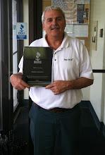Photo: Trugreen-LawnCare in Warwick, RI accepting their 25 Year Accreditation Achievement Plaque.