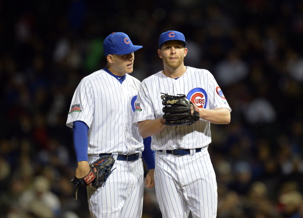 CHICAGO, IL - MAY 6:  First baseman Anthony Rizzo #44 of the Chicago Cubs (L) talks with relief pitcher Neil Ramirez #54 during the eighth inning against the Chicago White Sox at Wrigley Field on May 6, 2014 in Chicago, Illinois.  (Photo by Brian Kersey/Getty Images)