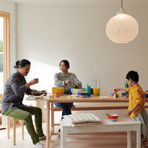 A young family gathers around a table at home.