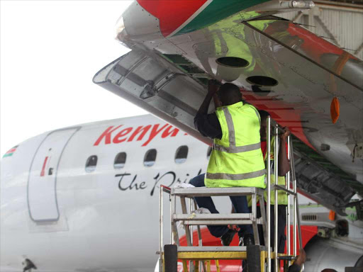 A KQ engineer services the wings of a Kenya Airways flight at the headquarter in Embakasi on April 26,2017