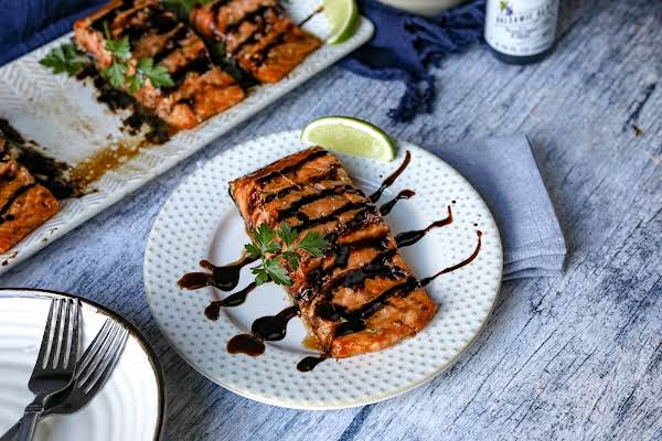 A Piece Of Grilled Salmon With Hoisin Sauce On A Plate.