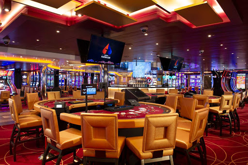 carnival-panorama-Casino.jpg - Carnival Panorama has a bright, new casino where you can try your luck at blackjack, roulette or slots.