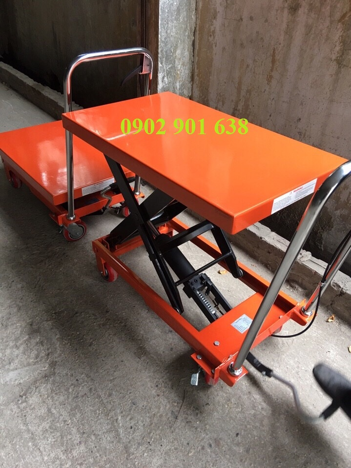 Cần bán Xe nâng mặt bàn 150kg, 300kg giá cực sốc