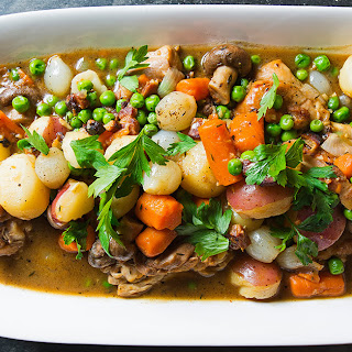 Braised Chicken with Potatoes, Carrots, Mushrooms and Peas.