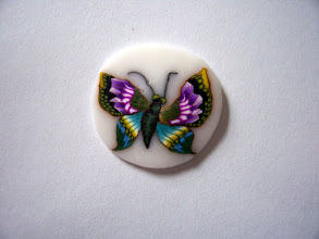 """Photo: Butterfly - 3, Colors: Violet, Purple, Blue, Green, Turquoise, Yellow, White, Black and more mixed multicolored butterfly. Very detailed. $6.00 per inch long with a Diameter of 1/2"""" inch, $13.50 per inch long with a Diameter of 3/4"""" and $24.00 per inch long with a Diameter of 1"""" around."""