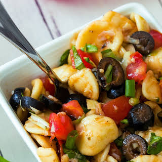 Healthy Orecchiette Pasta Salad with Basil, Olives and Tomatoes.