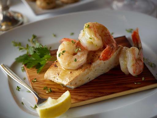 HAL-Pinnacle-Cedar-Plank-Halibut-&-Shrimp.jpg - A cedar plank halibut and shrimp dish served at Pinnacle Grill on your Holland America sailing.