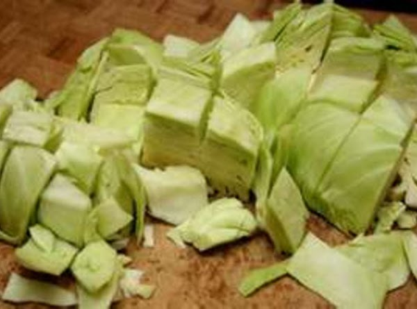 Frist chop & clean the cabbage. Then place in a large pot in layers....