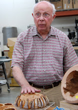 Photo: ... he pulled out a loaf of bread that he made and is using for inspiration for a new turning.