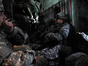 Photo: Several Red Bull Soldiers get a chance to relax on a C 130 Hercules during the short flight to Basra, Iraq, after spending a week in Kuwait for training. The 34th Infanty Division is currently deployed to Basra, Iraq in support of Operation Iraqi Freedom. Photo by Staff Sgt. Jamieson Pond of TheRedBulls.org.