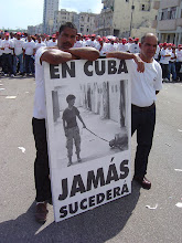 Photo: sign at a rally in havana. it reads: in cuba, this would never happen. tracey eaton photo.