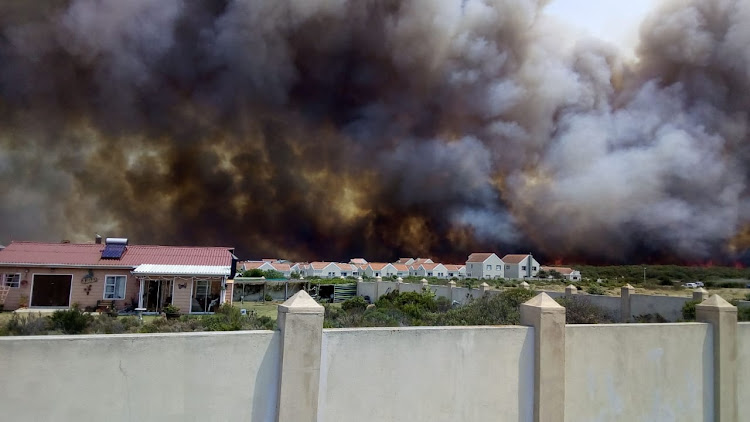 Fire threatens homes in the Overstrand on Friday January 11 2019. Evacuations were ordered in several suburbs.