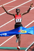 Photo: OSAKA, JAPAN - SEPTEMBER 02:  Catherine Ndereba of Kenya celebrates as she crosses the finish line to win the Women's Marathon on day nine of the 11th IAAF World Athletics Championships on September 2, 2007 at the Nagai Stadium in Osaka, Japan.  (Photo by Alexander Hassenstein/Bongarts/Getty Images)